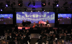 Duelling pianos on stage